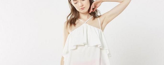 tops y blusas de fiesta low cost para la primavera asimetricos hombros al aire volantes
